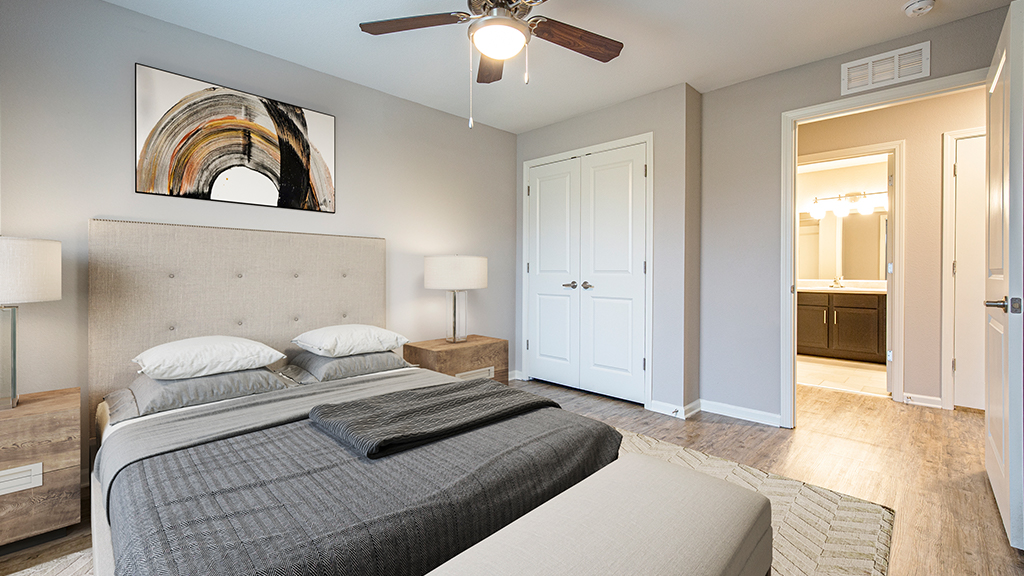Furnished primary bedroom suite at Patriot Pointe Apartments